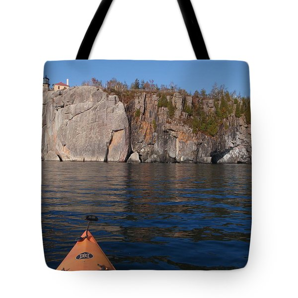 Tote Bag featuring the photograph Kayaking Beneath The Light by James Peterson