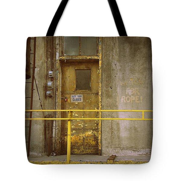 Tote Bag featuring the photograph Keep Door Closed by Joseph Skompski