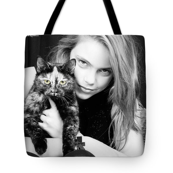 Tote Bag featuring the photograph Kitten Eyes by Stwayne Keubrick