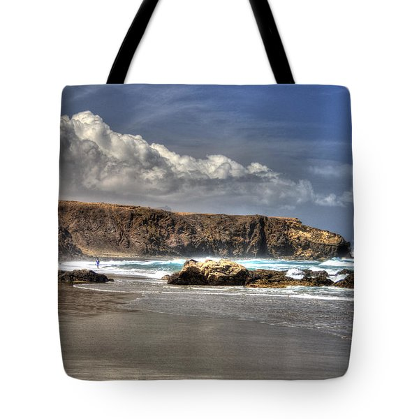 Tote Bag featuring the photograph La Pared Cliff And Rocky Beach On Fuertaventura Island by Julis Simo
