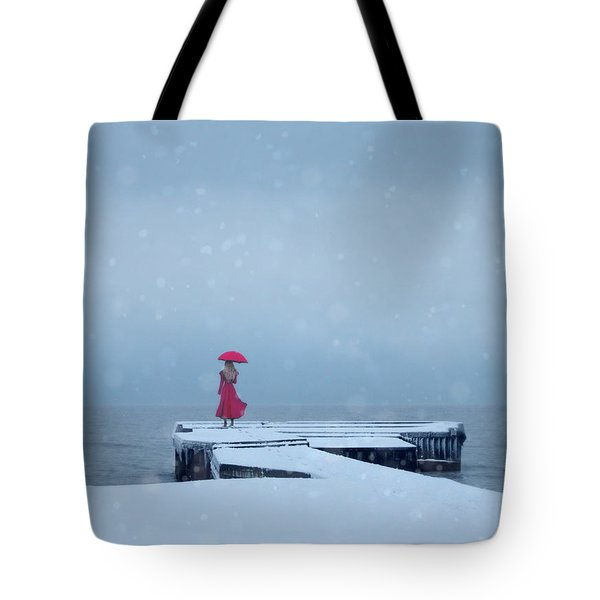Lady In Red On Snowy Pier Tote Bag by Jill Battaglia