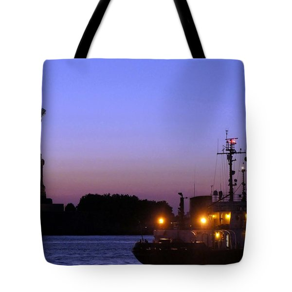 Tote Bag featuring the photograph Lady Liberty At Dusk by Lilliana Mendez