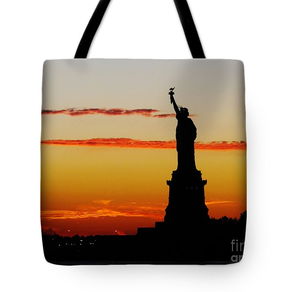 Tote Bag featuring the photograph Lady Liberty At Sunset by Susan Wiedmann