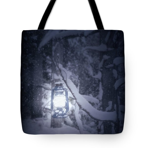 Lantern In Snow Tote Bag by Joana Kruse