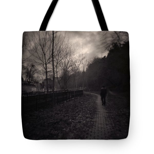 Last Alone Tote Bag by Taylan Apukovska