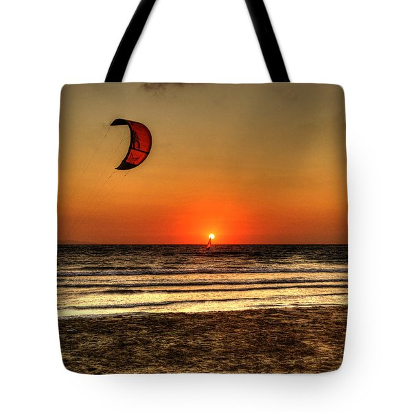 Tote Bag featuring the photograph Last Glipses Of Sun At Prasonisi Bay by Julis Simo