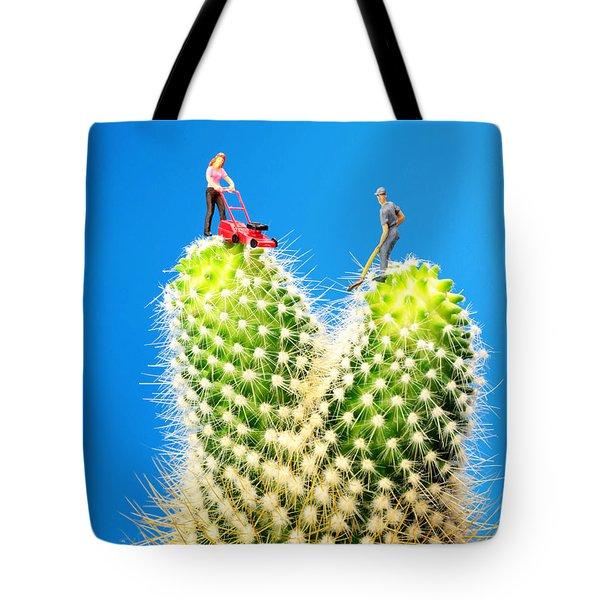 Lawn Mowing On Cactus Tote Bag by Paul Ge