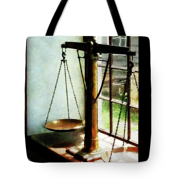 Tote Bag featuring the photograph Lawyer - Scales Of Justice by Susan Savad