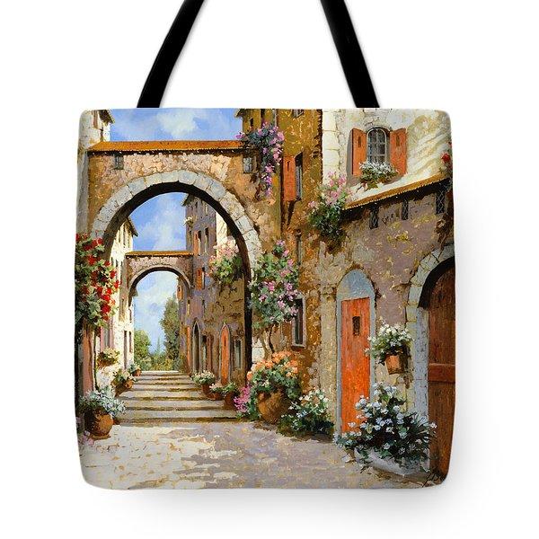Le Porte Rosse Sulla Strada Tote Bag by Guido Borelli