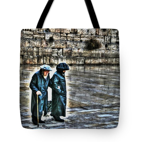 Tote Bag featuring the photograph Leaving The Western Wall In Israel by Doc Braham