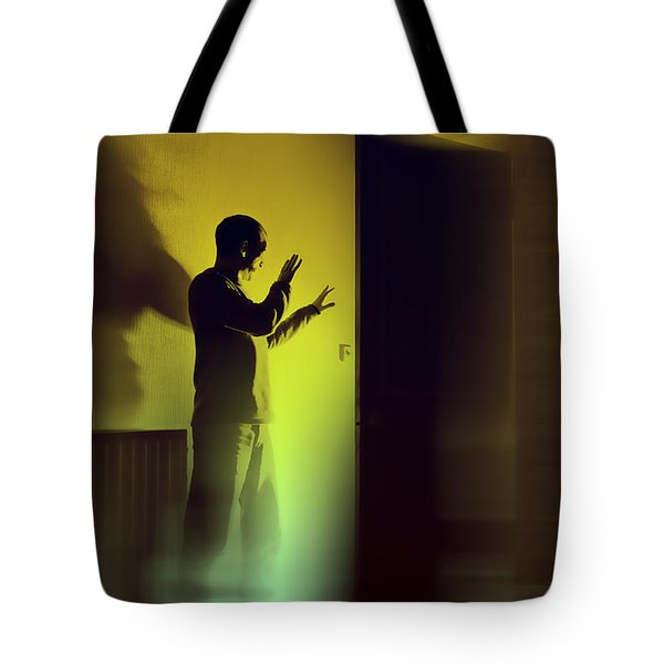 Tote Bag featuring the photograph Light Behind Door by Craig B