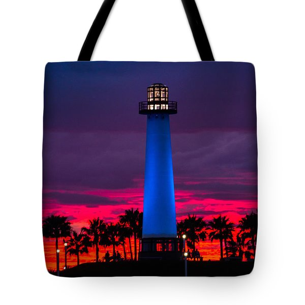 Light House In The Firey Sky Tote Bag by Denise Dube