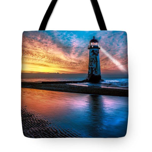 Tote Bag featuring the photograph Light House Sunset by Adrian Evans