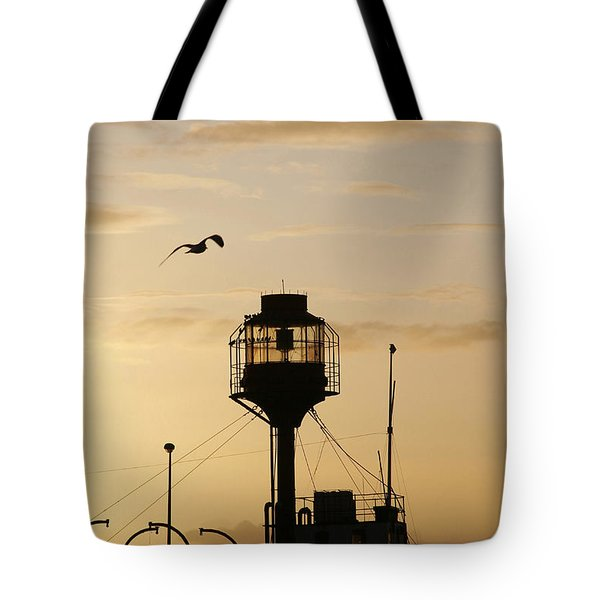 Light Ship Silhouette At Sunset Tote Bag