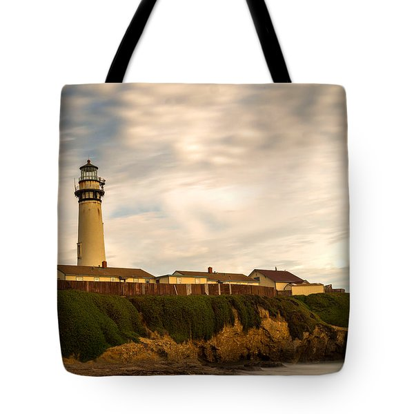 Lighthouse And Clouds Tote Bag