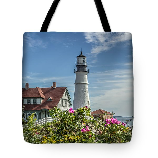 Tote Bag featuring the photograph Lighthouse And Wild Roses by Jane Luxton