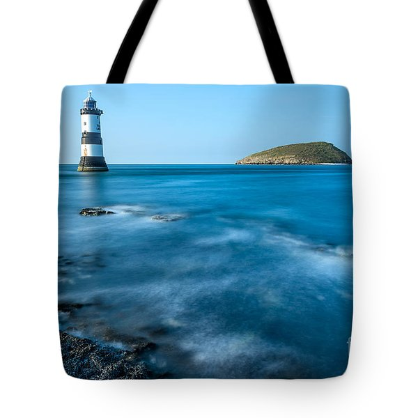 Lighthouse At Penmon Point Tote Bag by Adrian Evans