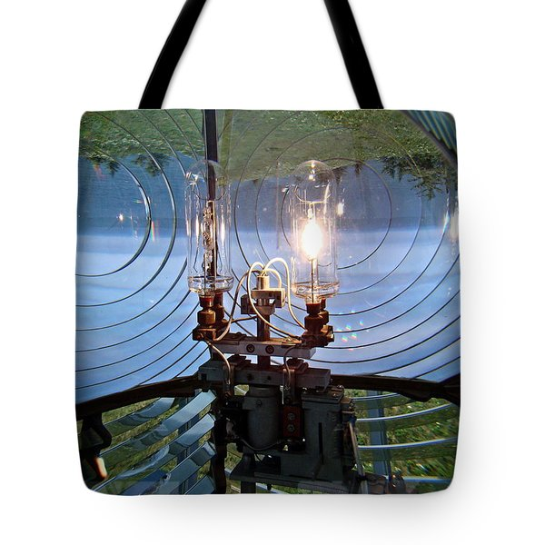 Tote Bag featuring the photograph Lighthouse Prism And Light by Nick Kloepping