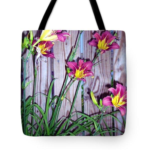 Lilies Against The Wooden Fence Tote Bag