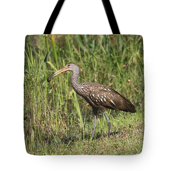 Tote Bag featuring the photograph Limpkin With Apple Snail by Christiane Schulze Art And Photography