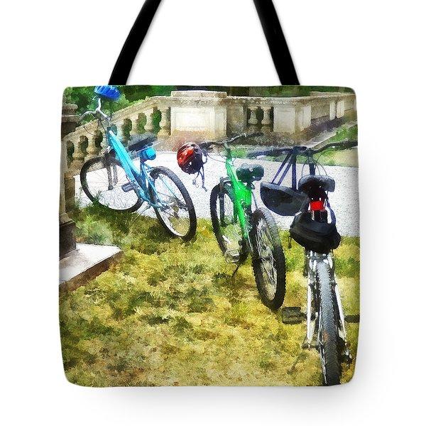 Line Of Bicycles In Park Tote Bag by Susan Savad