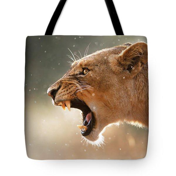 Lioness Displaying Dangerous Teeth In A Rainstorm Tote Bag