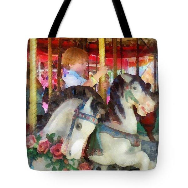 Little Boy On Carousel Tote Bag by Susan Savad