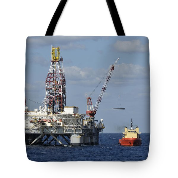 Tote Bag featuring the photograph Loading Oil Pipe by Bradford Martin