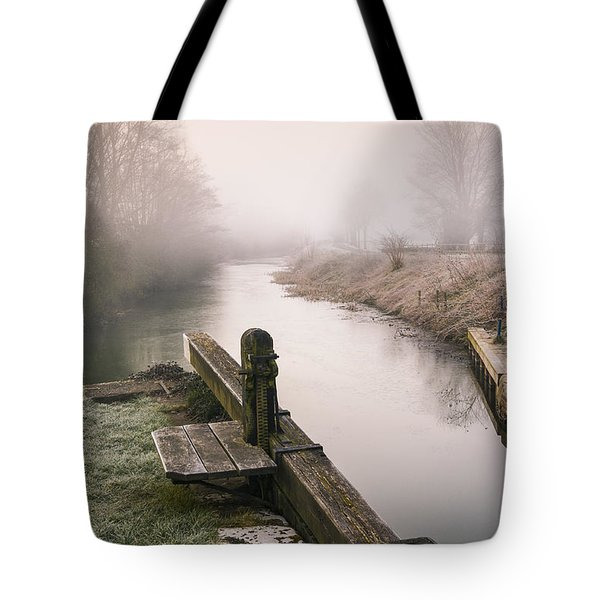 Tote Bag featuring the photograph Lock Gates On A Still Misty Morning. by Trevor Chriss