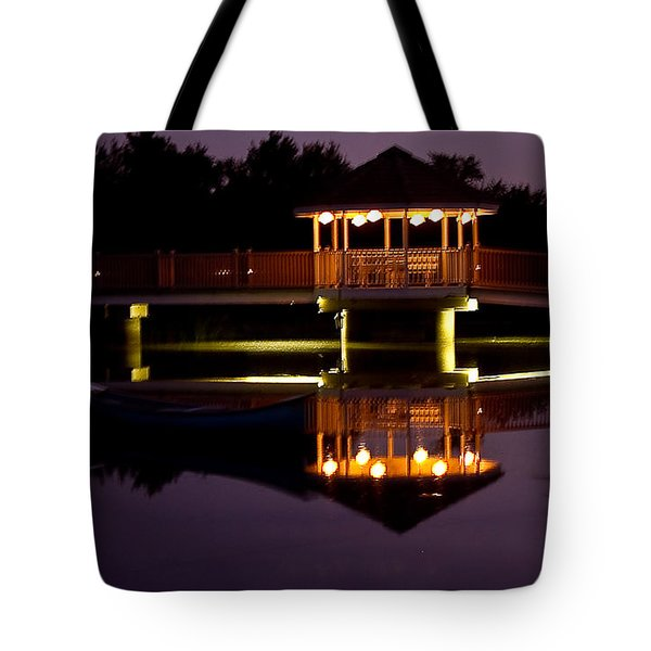 Tote Bag featuring the photograph Lone Canoe by Brian Williamson