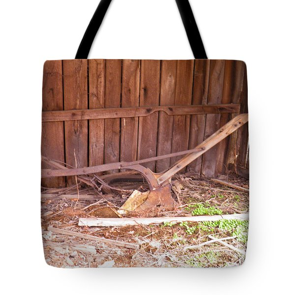 Tote Bag featuring the photograph Lone Plow by Nick Kirby