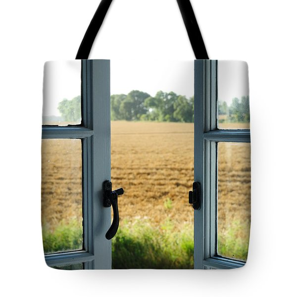 Looking Through A Window Tote Bag