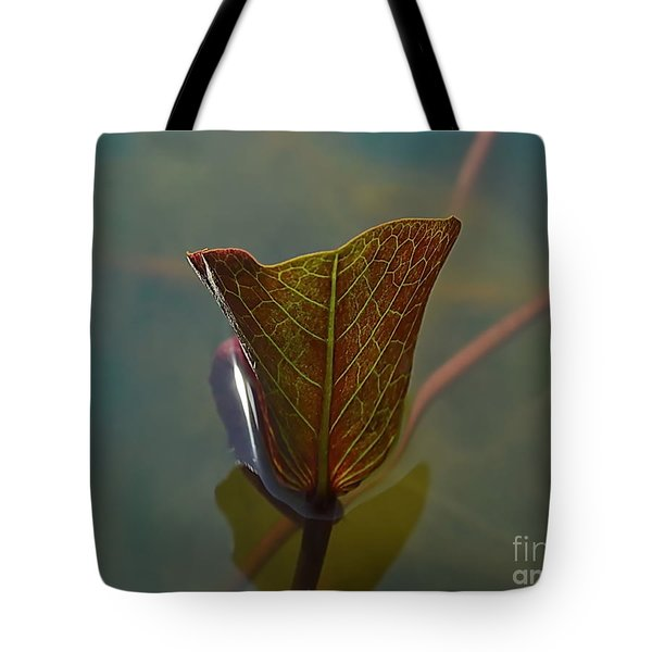 Tote Bag featuring the photograph Lotus Leaf by Michelle Meenawong