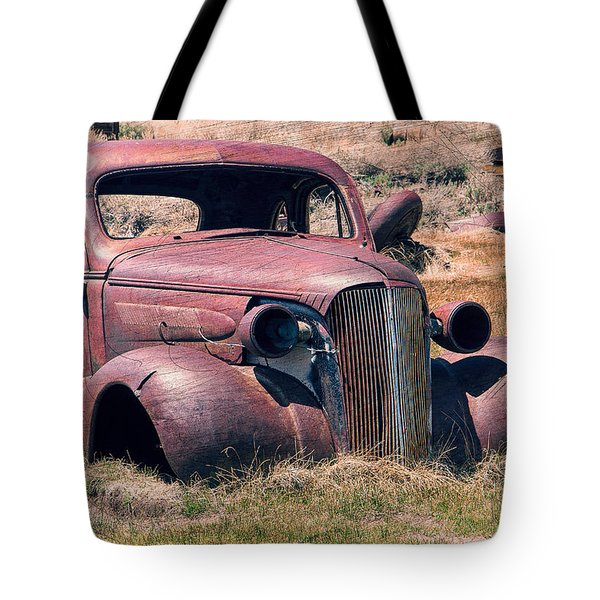 Tote Bag featuring the photograph Low Rider by Steven Bateson