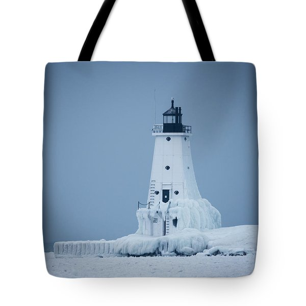 Ludington North Pier Lighthouse In Winter Tote Bag