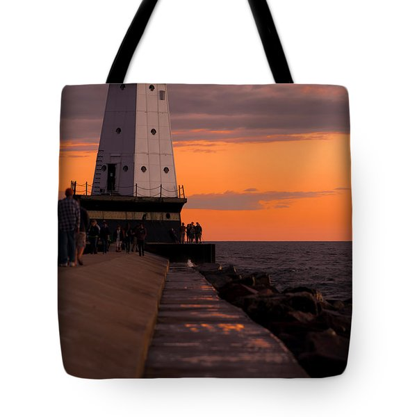 Ludington Pier And Lighthouse Tote Bag by Sebastian Musial