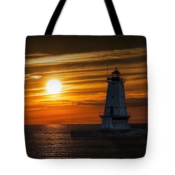 Ludington Pier Lighthead At Sunset Tote Bag by Randall Nyhof