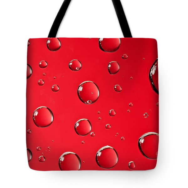 Macro Water Drop On Red Tote Bag by Sharon Dominick