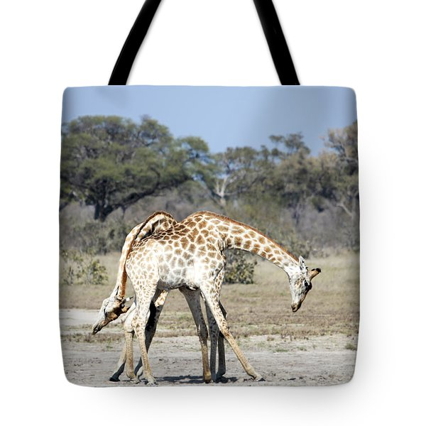 Tote Bag featuring the photograph Male Giraffes Necking by Liz Leyden
