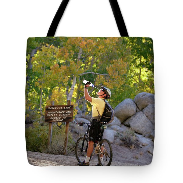 Man Drinking Water Along The Flume Tote Bag