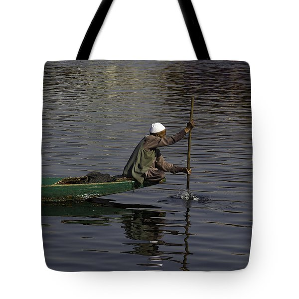 Man Plying A Wooden Boat On The Dal Lake Tote Bag