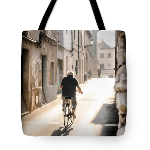 Man Riding Bicycle In Street In Puerto Pollenca Tote Bag