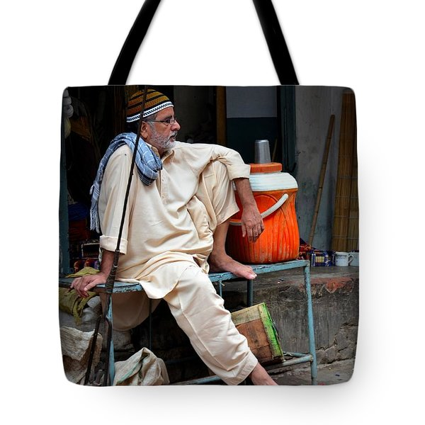 Man Sits And Relaxes In Lahore Walled City Pakistan Tote Bag