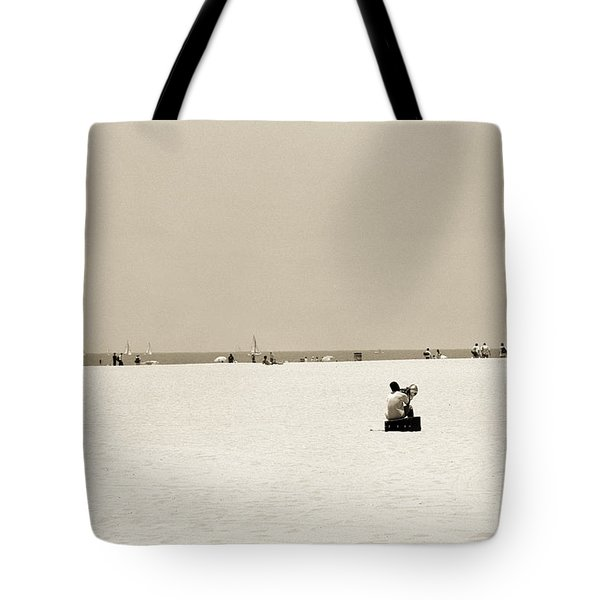 Man Sitting On A Beach Playing His Horn Tote Bag by Stephen Spiller