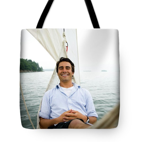 Man Smiling On Hammock Onboard Tote Bag
