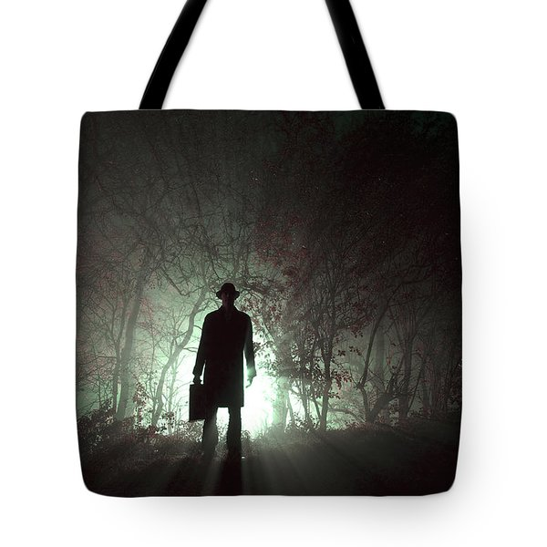 Tote Bag featuring the photograph Man Waiting In Fog With Case by Lee Avison