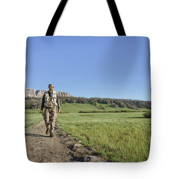 Man Walking With Fishing Rod Tote Bag