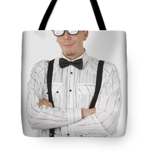 Man Wearing Sunglasses Suspenders And Tote Bag by Stock Foundry