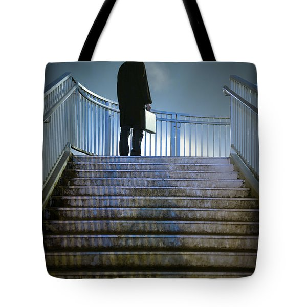 Tote Bag featuring the photograph Man With Case At Night On Stairs by Lee Avison