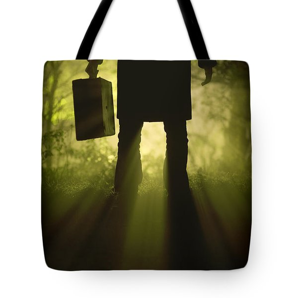 Tote Bag featuring the photograph Man With Case In Fog by Lee Avison